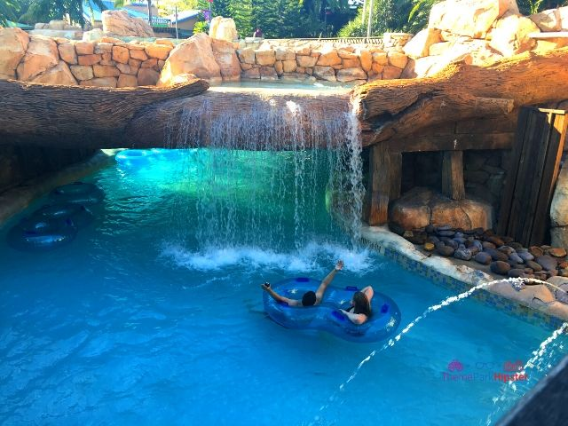 Aquatica SeaWorld Orlando Florida Water Park Blue Lazy River with Riders in Tube under Water Fall