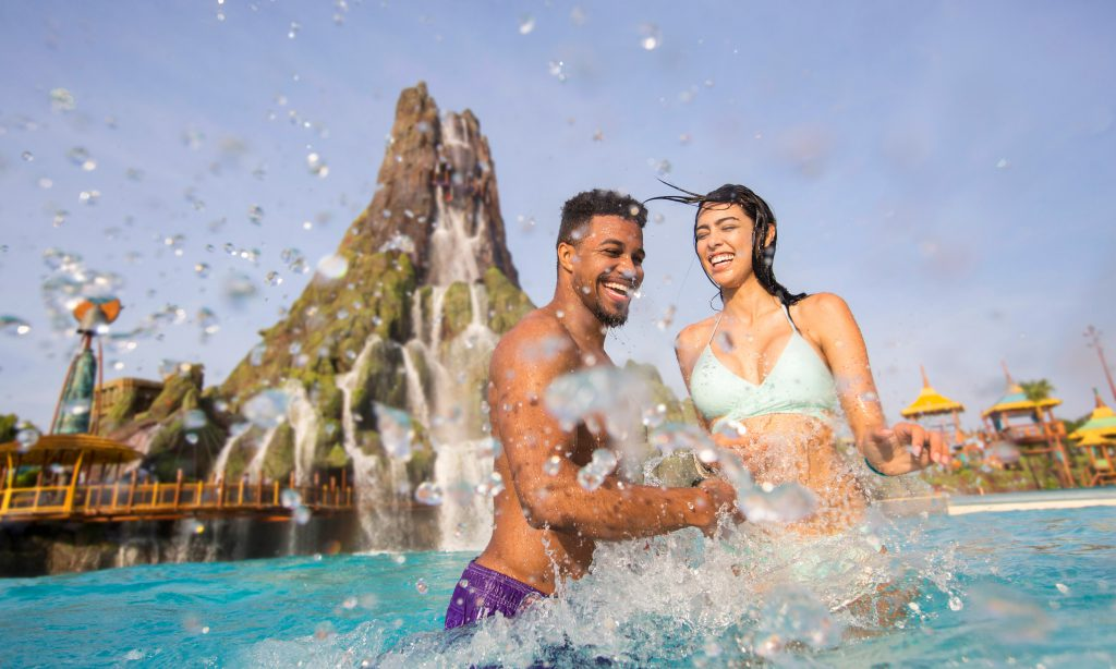 Things to do at Universal Orlando Couples splash in the water at Volcano Bay