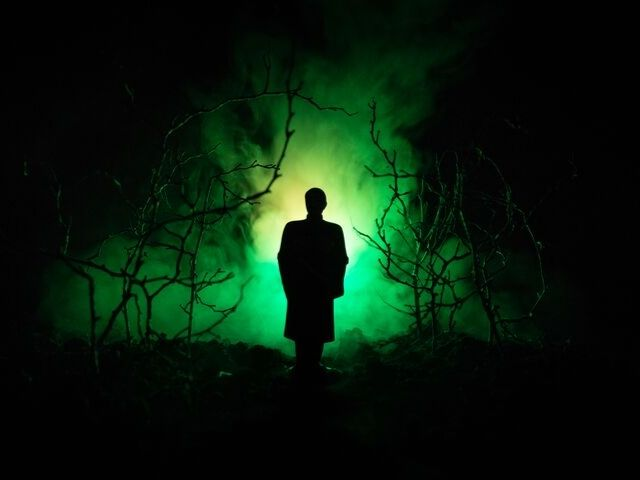 Things to Do in Orlando for October. Halloween haunted house in Orlando with creepy man in green fog.