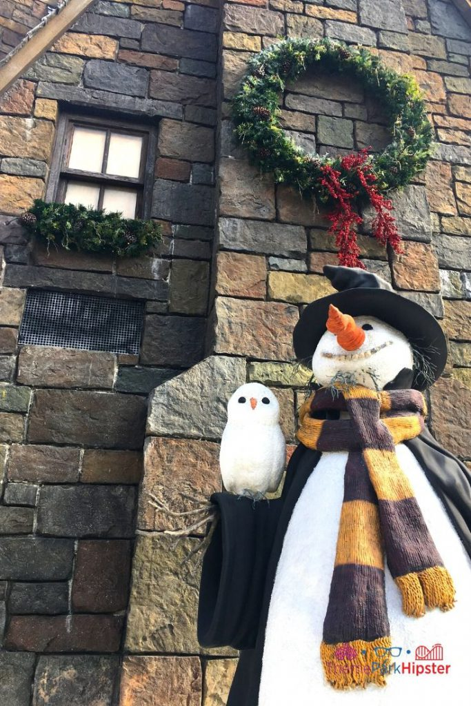 Christmas at Universal Harry Potter Christmas Snowman in front of castle