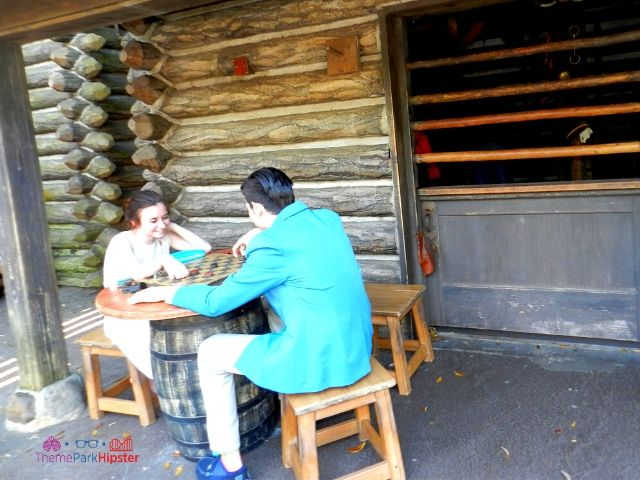 Dapper Day Disney World Tom Sawyer Island Fort with People Playing Checkers