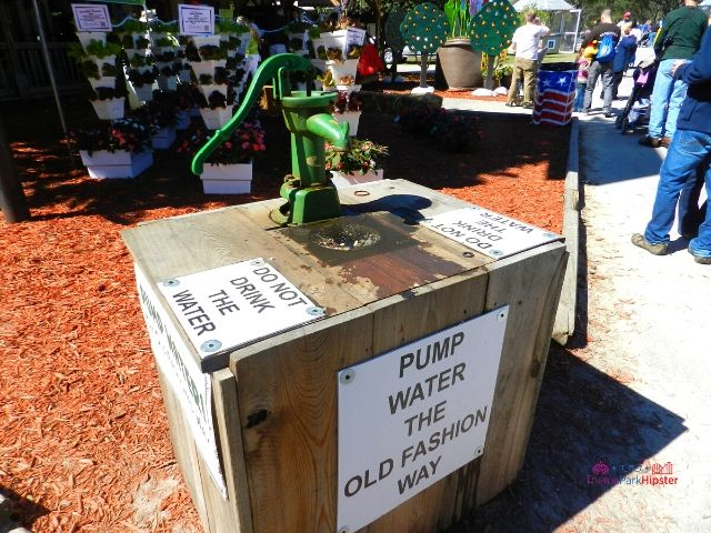 Florida State Fair Hydroponics Gardening Old Fashion Green Water pump with Red Barn House for the Ag Venture Education