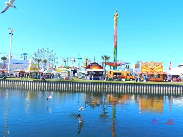 Florida State Fair Rides in front of water