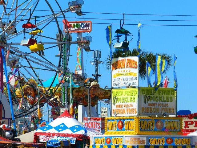 Florida State Fair Rides with Ferris Wheel and Food Kiosks