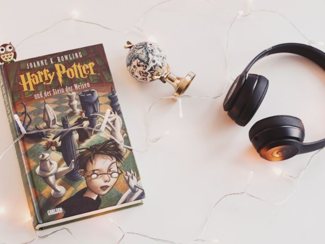 Harry Potter Book Series Universal Studios with book next to headphones.