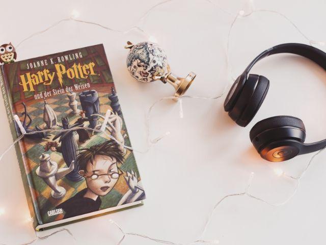 Harry Potter Book Series Universal Studios with book next to headphones.
