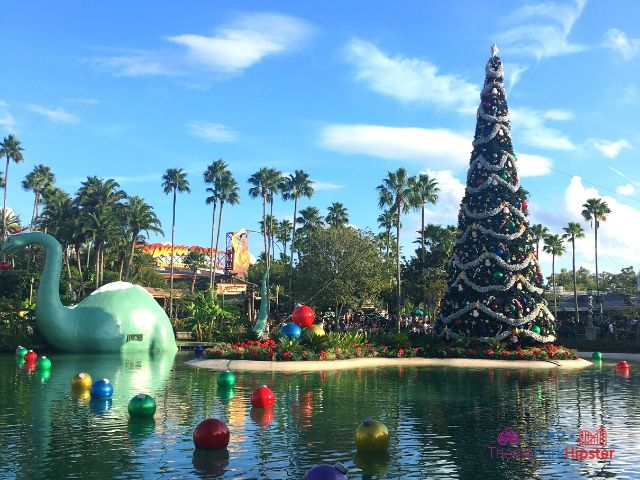 Christmas at Hollywood Studios Decorate Dinosaur in Santa Hat on Lake Echo