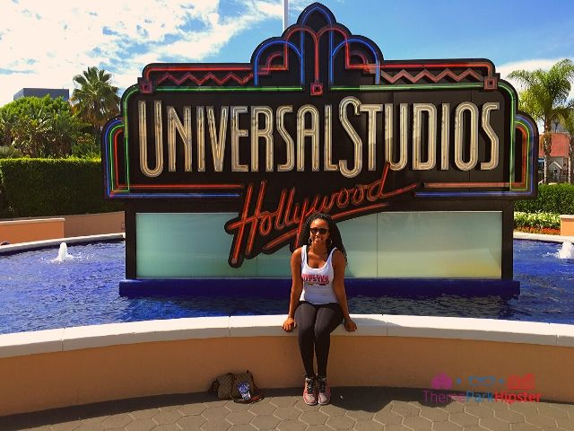 Solo Traveler NikkyJ in front of classic Universal Studios Hollywood sign