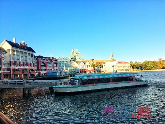 Boardwalk Inn Resort with Disney Boat on the Lagoon a free ride. Easy ways to do Disney World on a budget.