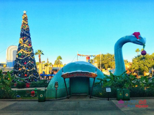Dinosaur Gertie's Ice Cream Shop at Hollywood Studios with Christmas Tree in the background.