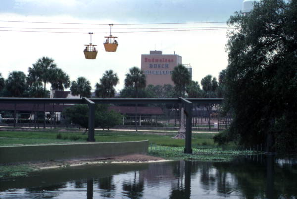 View showing gondola skyride at the Busch Gardens amusement park in Tampa Florida next to Anheuser-Busch Brewery