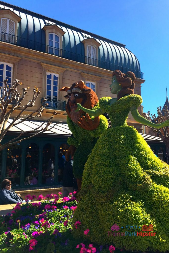 Beauty and the Beast Topiary Epcot Flower and Garden Festival. Safety tips for solo travel.