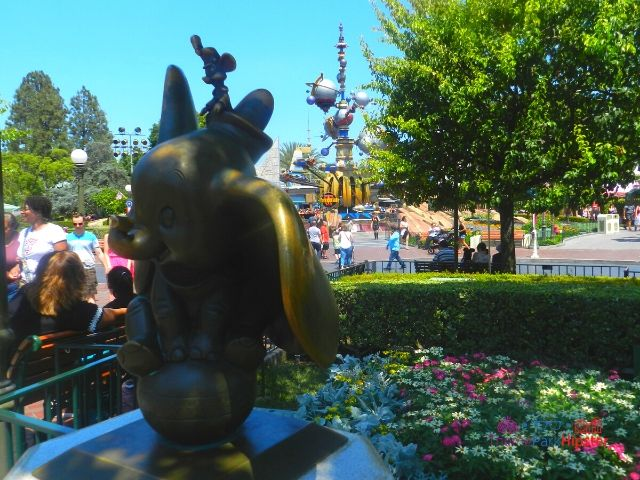 Disneyland Dumbo Statue with Tomorrowland in the Background