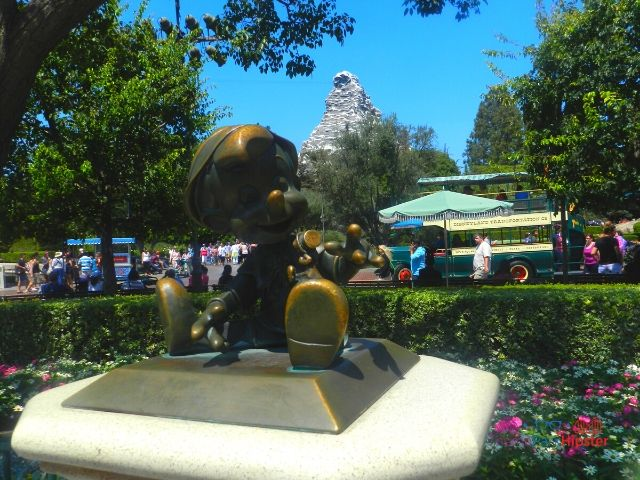 Disneyland Pinocchio Statue with Matterhorn in the Background