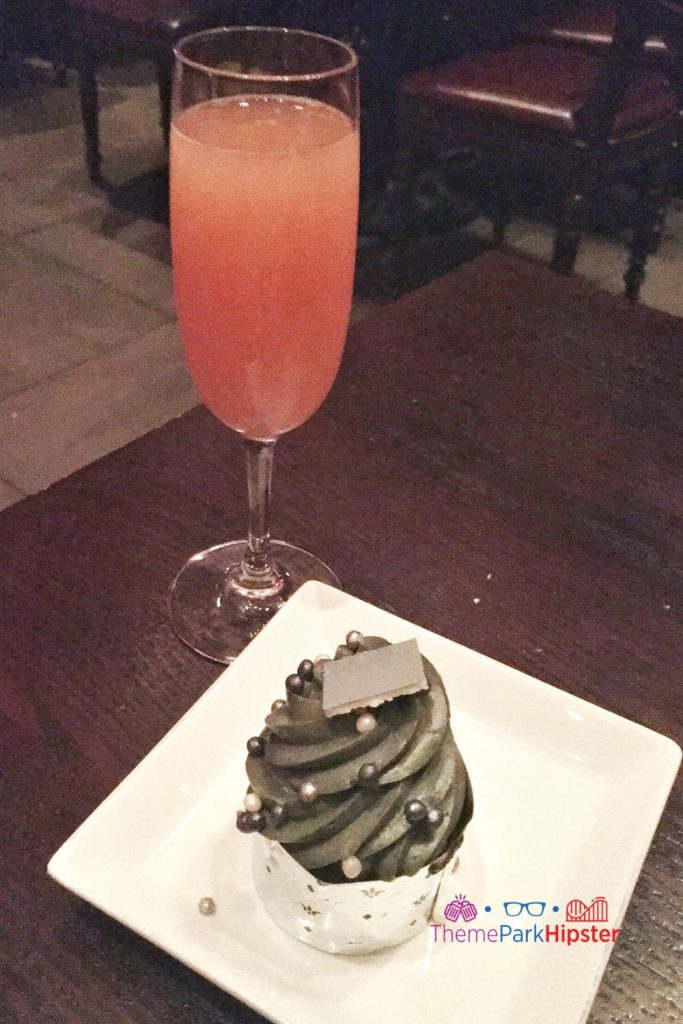 Be Our Guest Restaurant Peach Bellini and Grey Stuff Cupcake. best disney park for adults