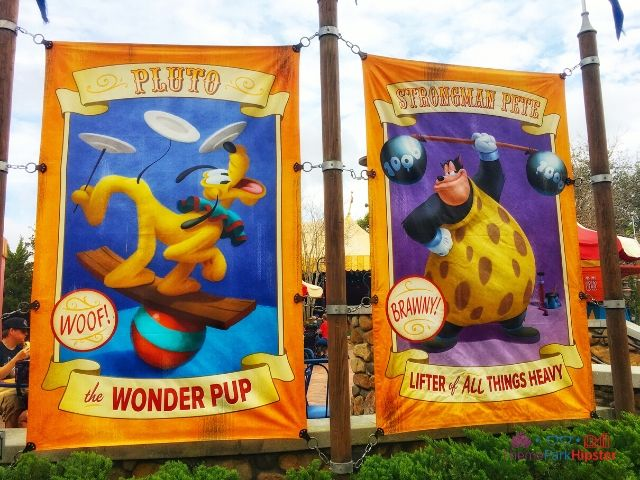 Magic Kingdom New Fantasyland Storybook Pluto and Pete Signs. Making it good to know how much does Disney World Cost.