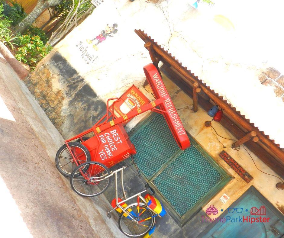 Animal Kingdom Harambe Village with Wanjohi Refreshment Red Bike