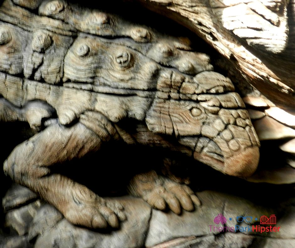 Animal Kingdom Tree of Life with Lizard Animal Carved inside of it