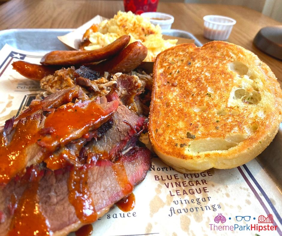 Regal Eagle Smokehouse at Epcot Beef Brisket covered in barbecue sauce with cream mac and cheese and buttery toast