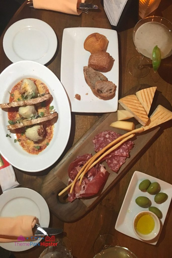 Tutto Gusto Wine Cellar in Italy Pavilion at Epcot Charcuterie Board with meatballs olives and Italian margarita