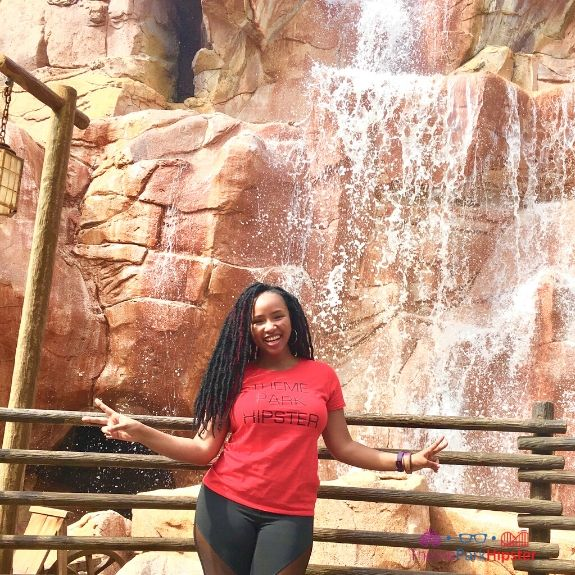 NikkyJ of ThemeParkHipster in Front of Waterfall in Canada Pavilion at Epcot