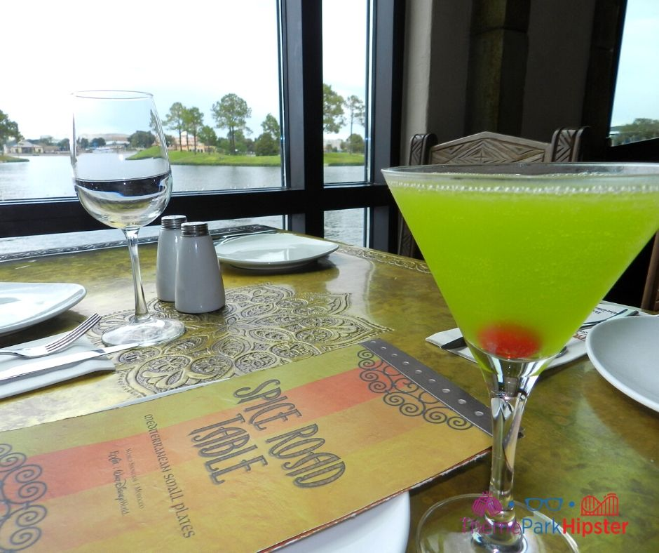 Spice Road Table at Epcot Green Martini over looking World Showcase Lagoon