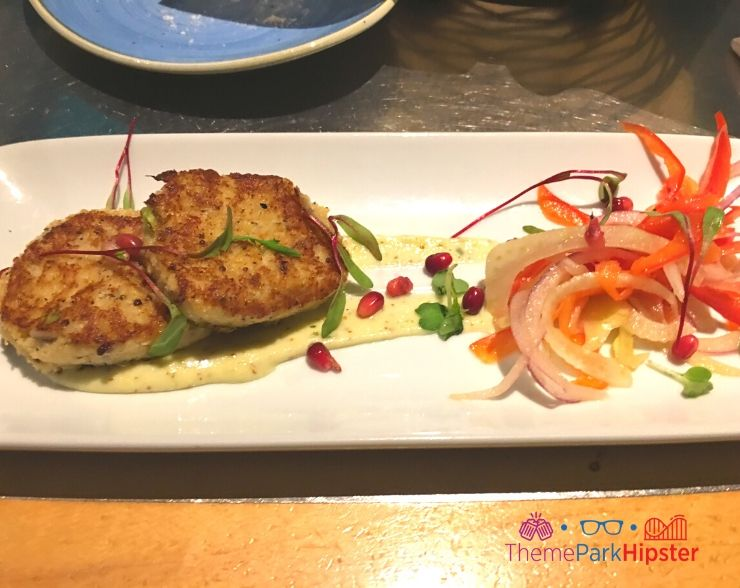 Living Seas restaurant at Epcot Crab Cake over carrot and onion salad