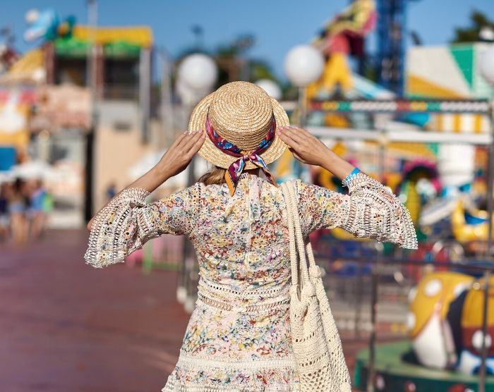 Solo Travel Tips for Theme Parks with Woman at Carnival