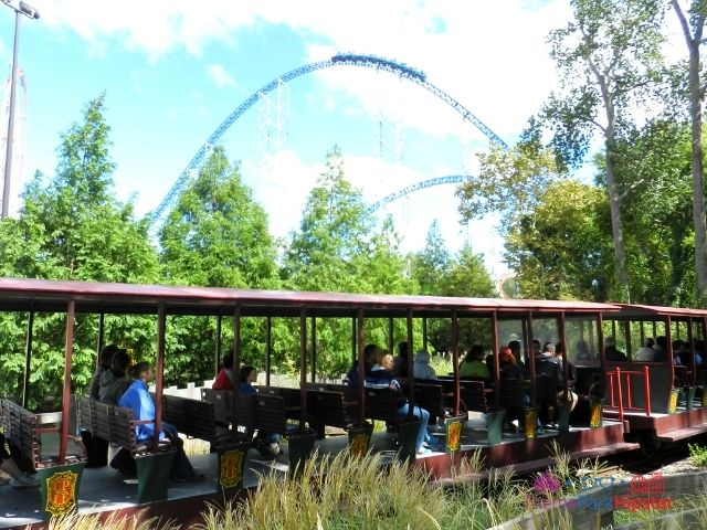 Millennium Force train going over curve with train going by at Cedar Point