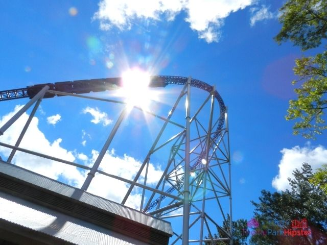 Millennium Force train going over the curve with sun kiss at Cedar Point