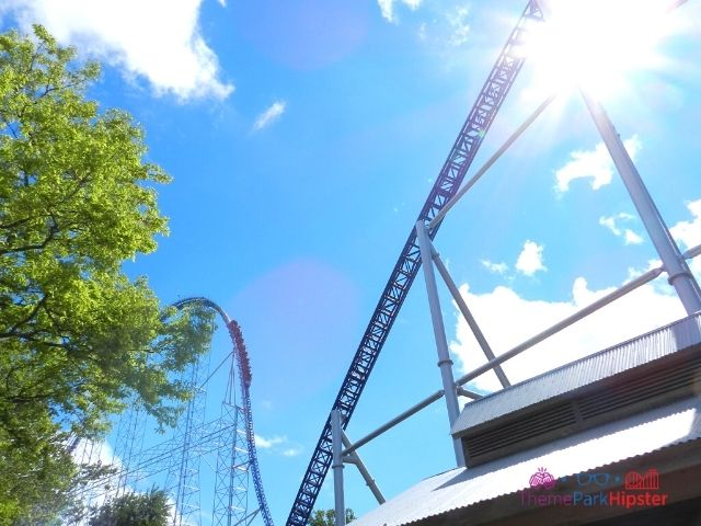 Millennium Force train going over the top drop with sun kiss at Cedar Point