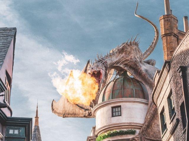 Dragon breathing fire on top of Gringotts Bank in Diagon at Universal Studios