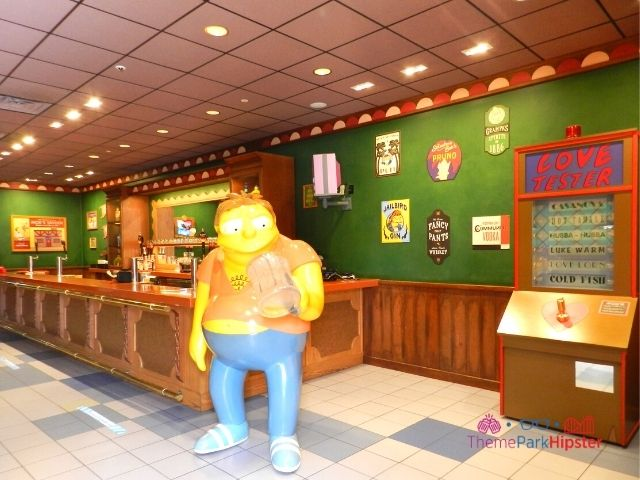 Moes Tavern Interior with Barnie Gumble and Love Tester Machine