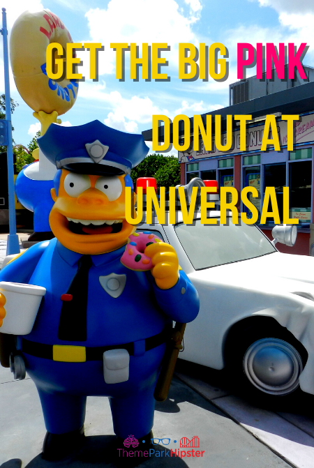 Lard Lad Big Yellow Donut with boy in blue overalls statue