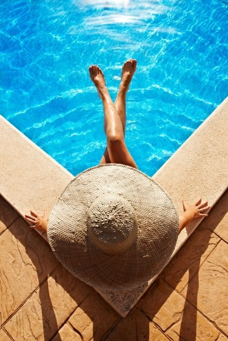 Woman poolside recovering from jetlag