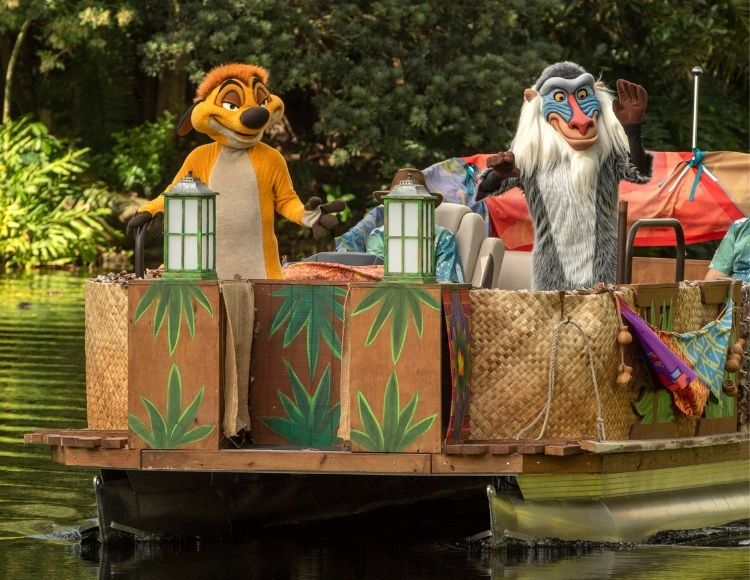 Timon (left) and Rafiki (right) sail down Discovery River as part of the holiday celebrations happening at Disney's Animal Kingdom at Walt Disney World Resort in Lake Buena Vista, Fla. (Kent Phillips, photographer)