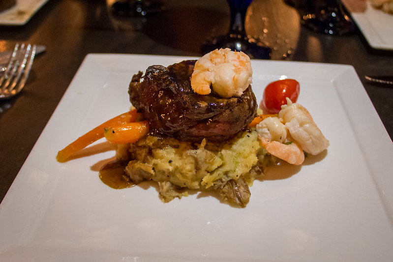 At Cinderella's Royal Table Beef and Shrimp - Grilled Beef Tenderloin with Crushed Fingerling Potato Confit, Shrimp, and Seasonal Vegetables. One of the best disney world restaurants.