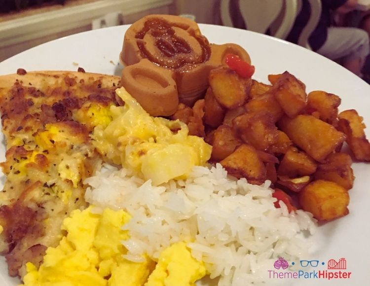 Best Breakfast at Disney with Mickey Waffle eggs and hashbrowns Tusker House Animal Kingdom