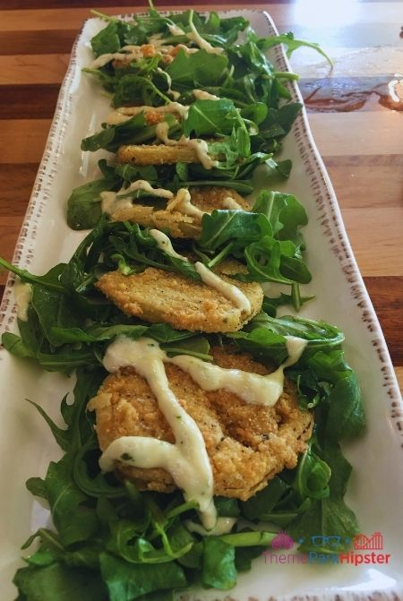Homecomin Disney Springs Fried Green Tomatoes on a bed of arugula