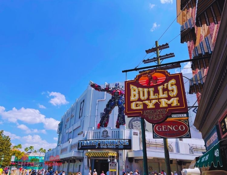 Transformers the Ride 3D Entrance next to Bull's Gym Sign