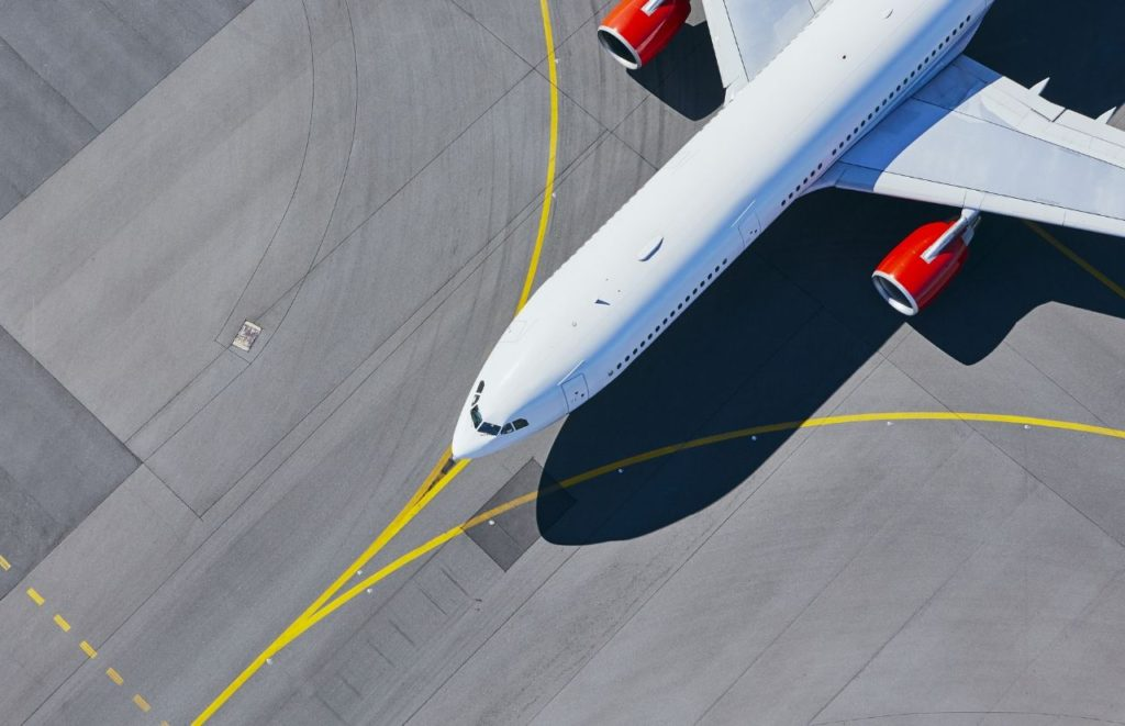 Airplane on road Cheap Flights to Orlando