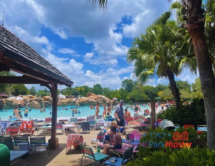 Wave pool with people sitting on the beach at Blizzard Beach Water Park