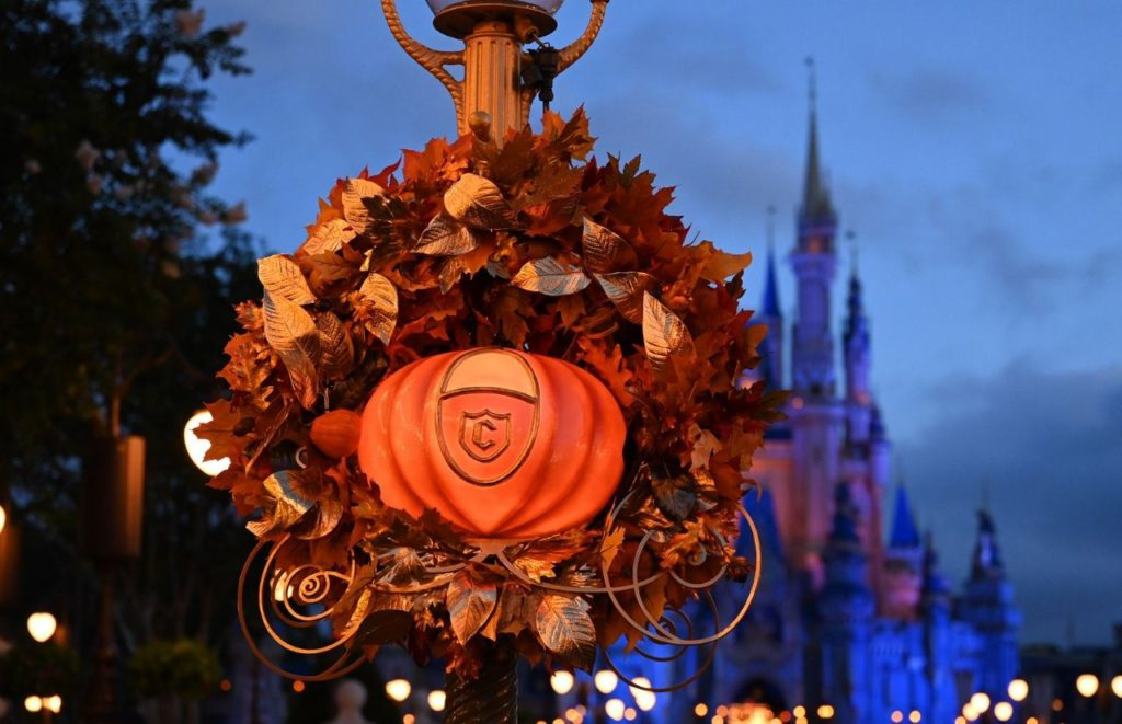 Just as Fairy Godmother turned a pumpkin into Cinderella's coach with her wand festive fall-themed wreaths on Main Street, U.S.A. Photographer Todd Anderson Disney World 50th Anniversary Celebration.